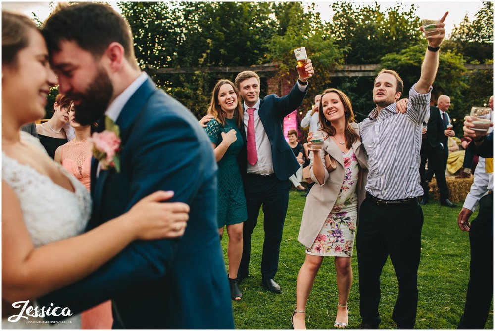 guests celebrating during the first dance
