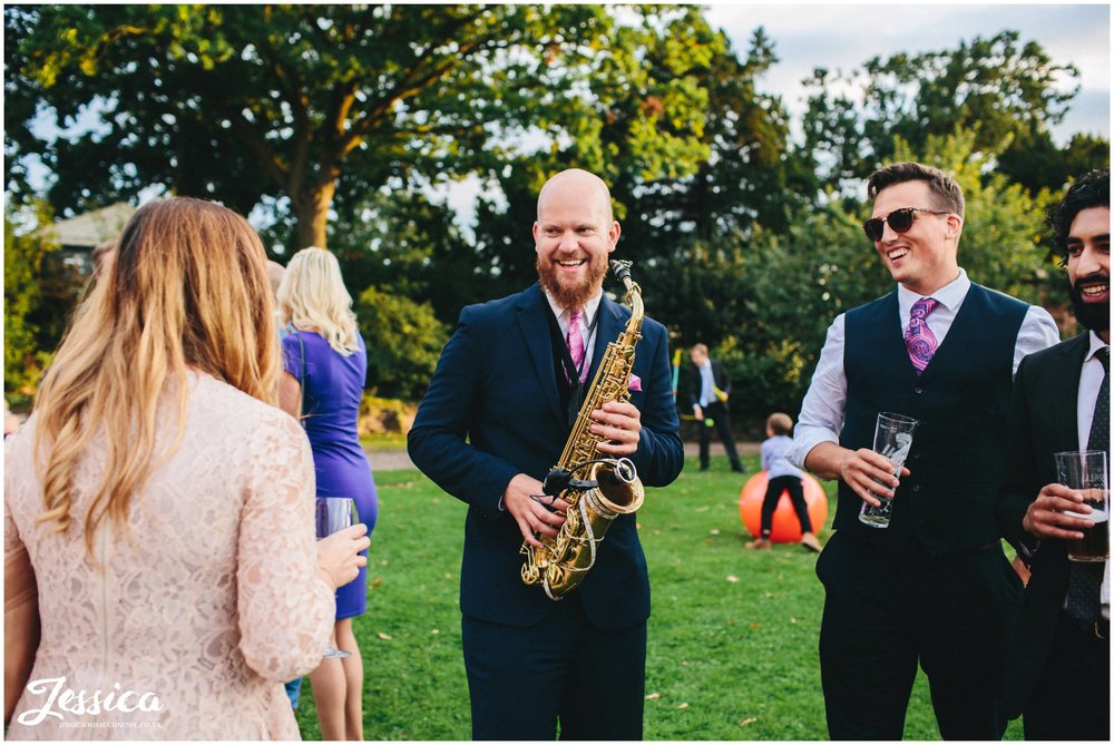 saxophone playing to guests outside willington hall