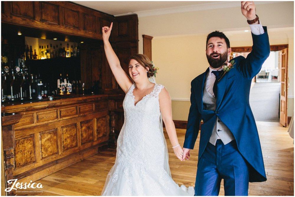 bride and groom are announced into their wedding breakfast - willington hall wedding