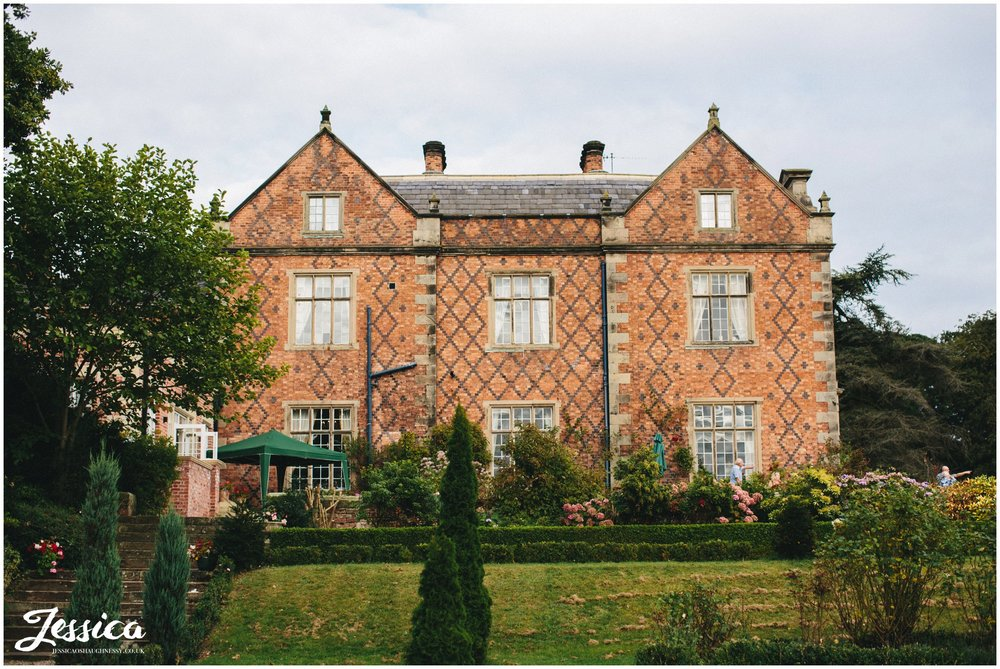 a view of willington hall at a cheshire wedding