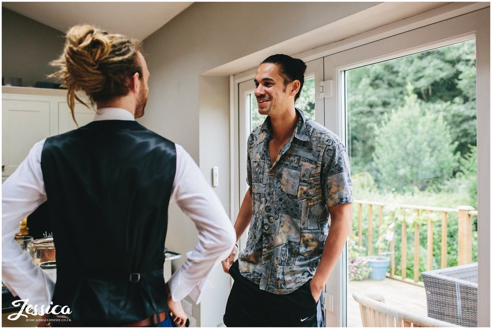 groom jokes around with his best man before the wedding in Cheadle