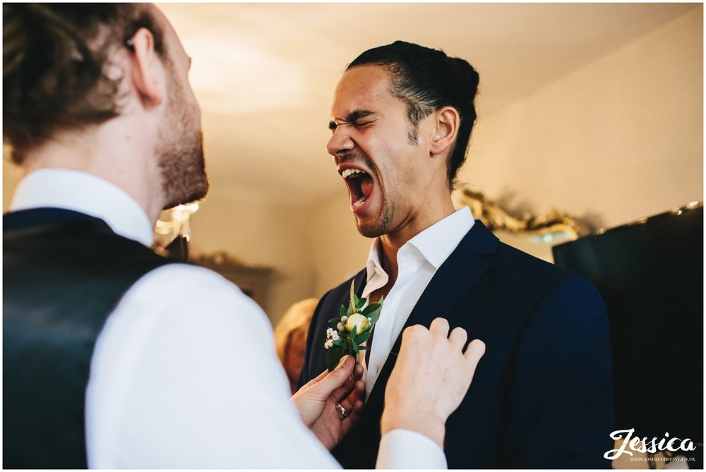 groom cries out when pricked with buttonhole pin