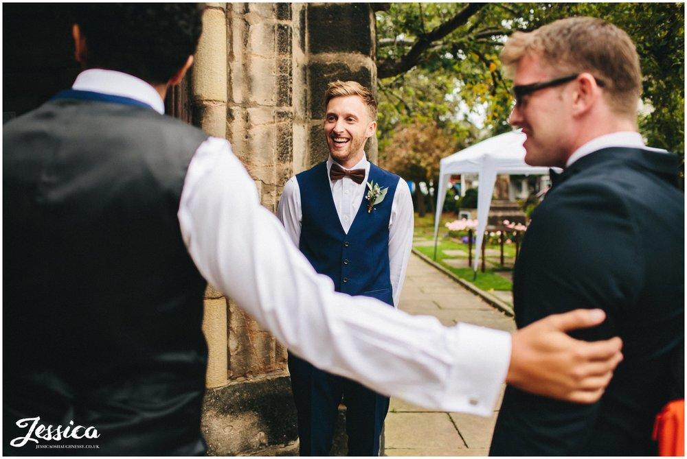 groomsmen greet guests at cheadle church