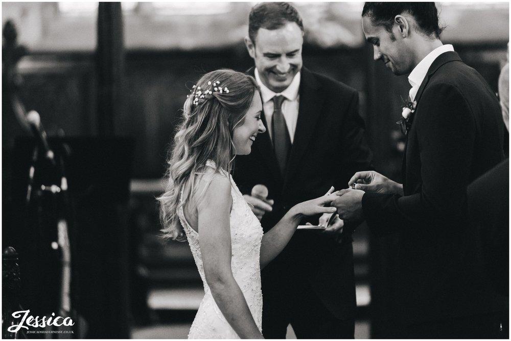 cheadle wedding photography - the couple exchange rings