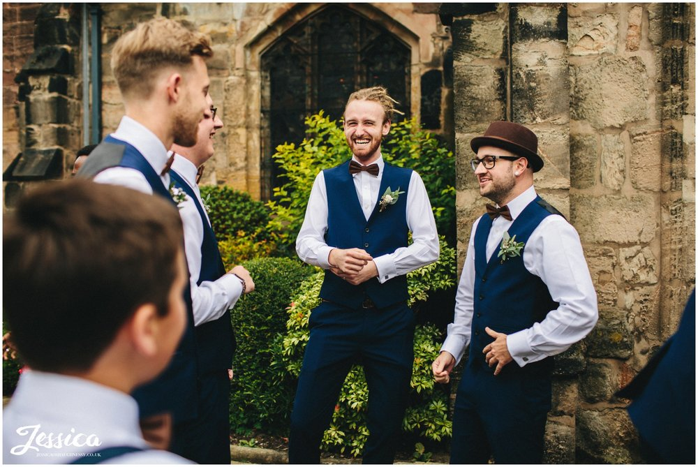 groomsmen celebrate the marriage after the service