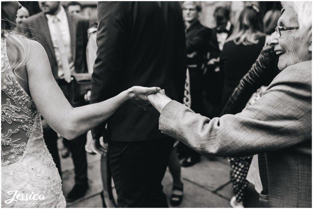 bride holds her grandmas hand