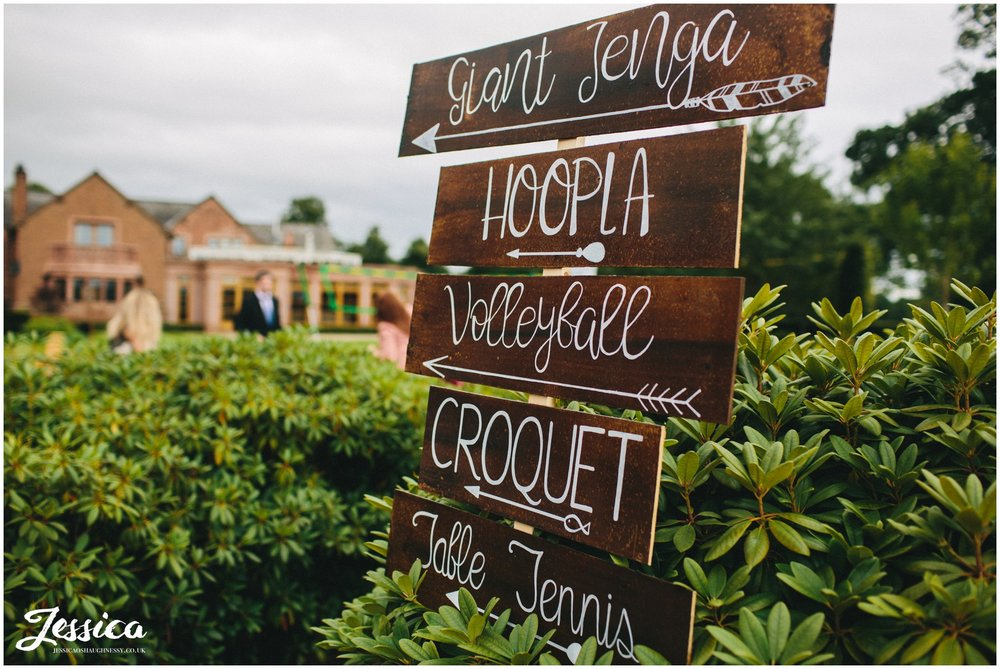 handmade signs point to outdoor party games