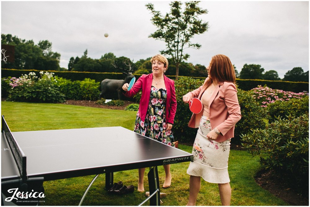 guests play ping pong at merrydale manor in cheshire