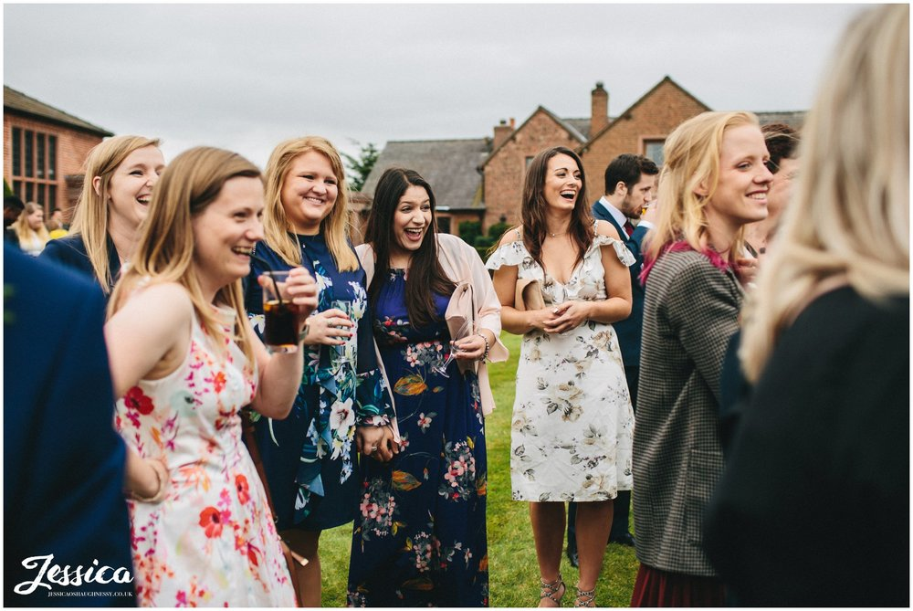 guests laughing at the newly wed's
