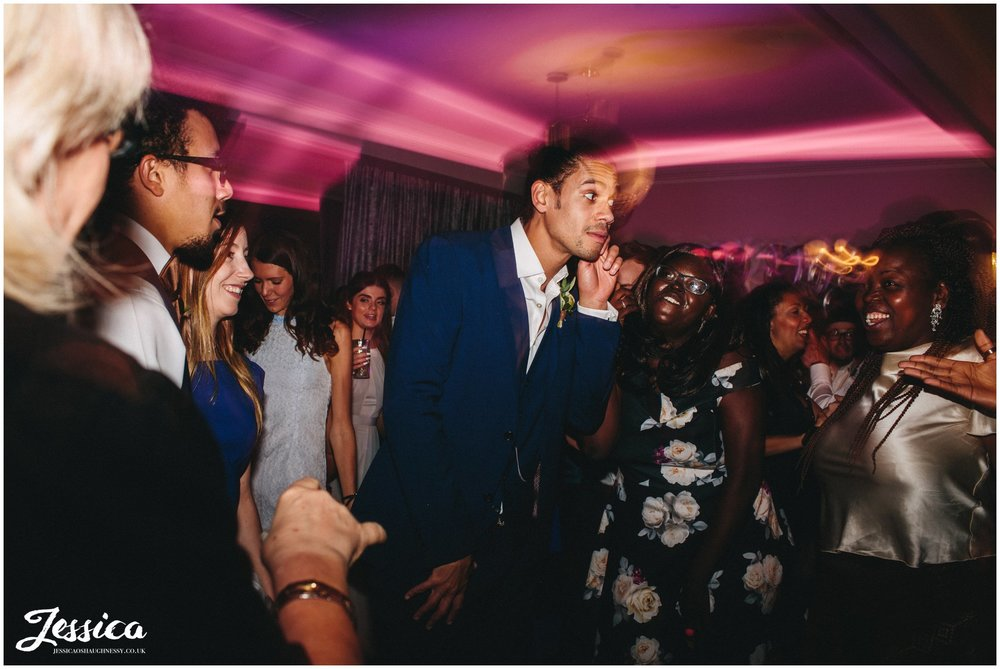 groom dancing with his friends on his cheshire wedding day