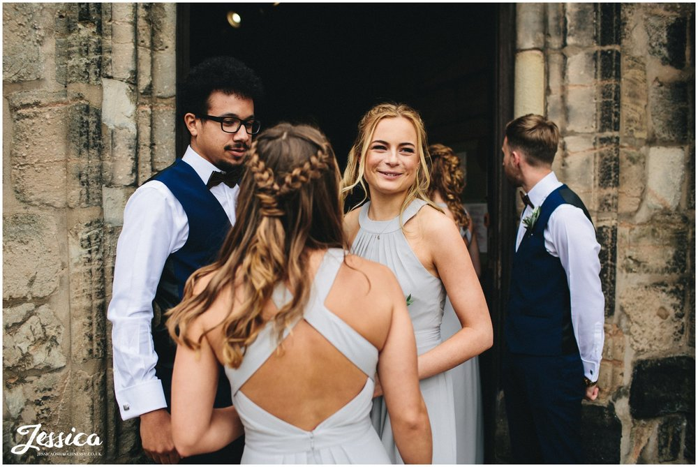 bridesmaids arrive before the wedding ceremony in cheadle