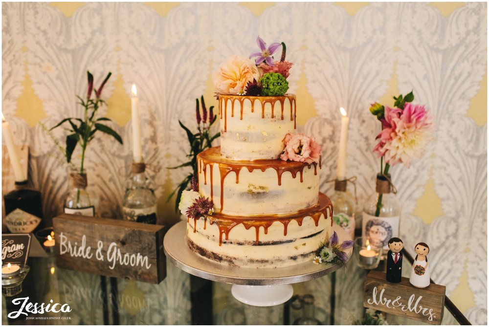 floral wedding cake with caramel drips