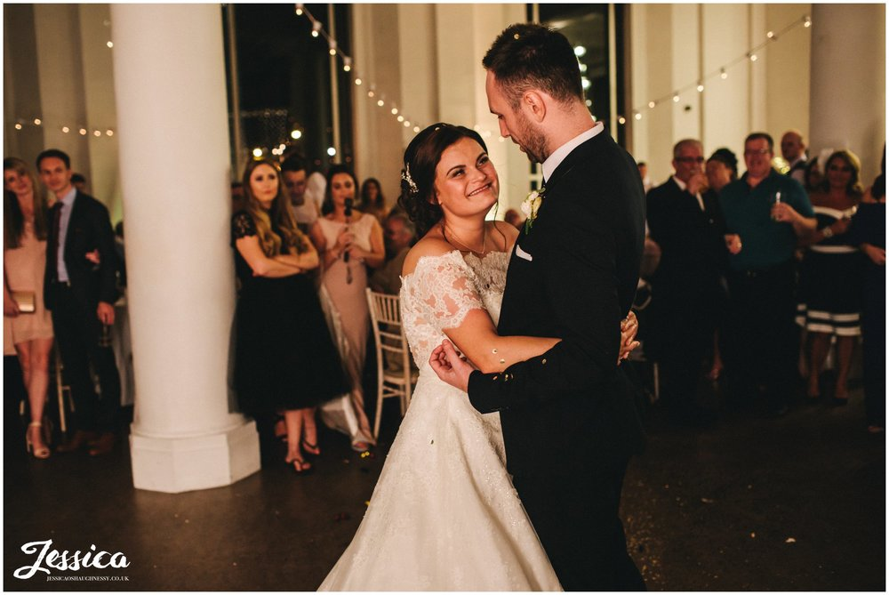 husband and wife share their first dance