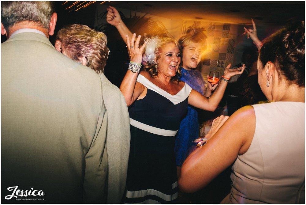 brides aunty celebrates on the dancefloor - liverpool wedding photographer