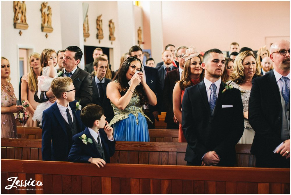 guest cry during the ceremony at Holy rosary church