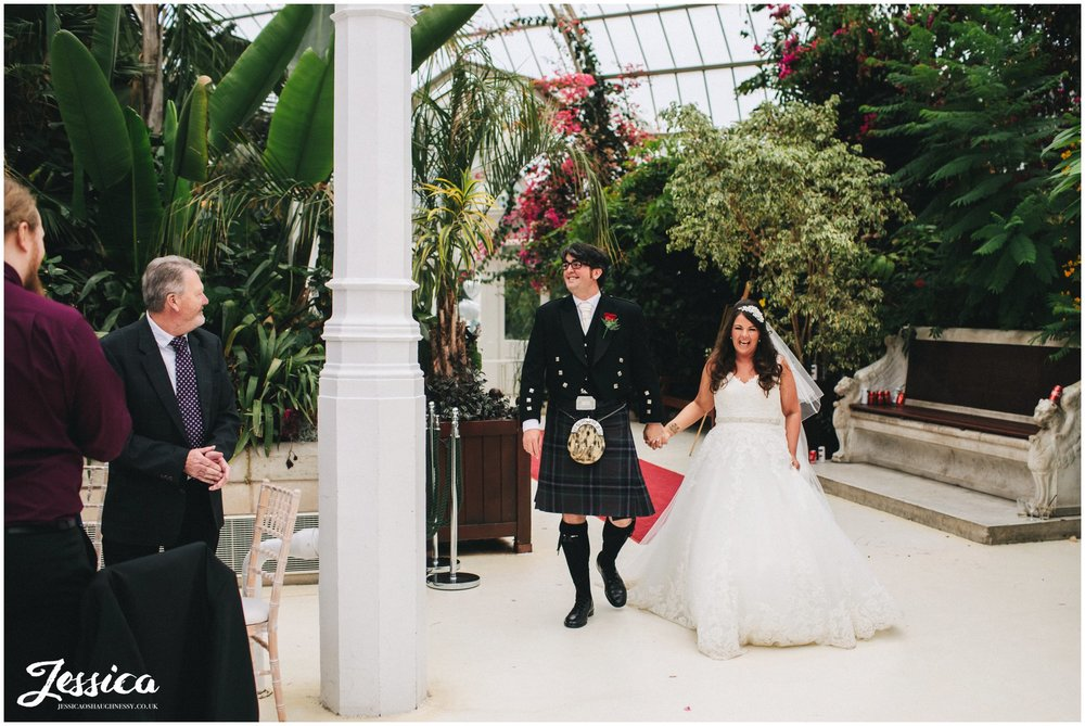 newly weds make entrance at sefton palm house in liverpool