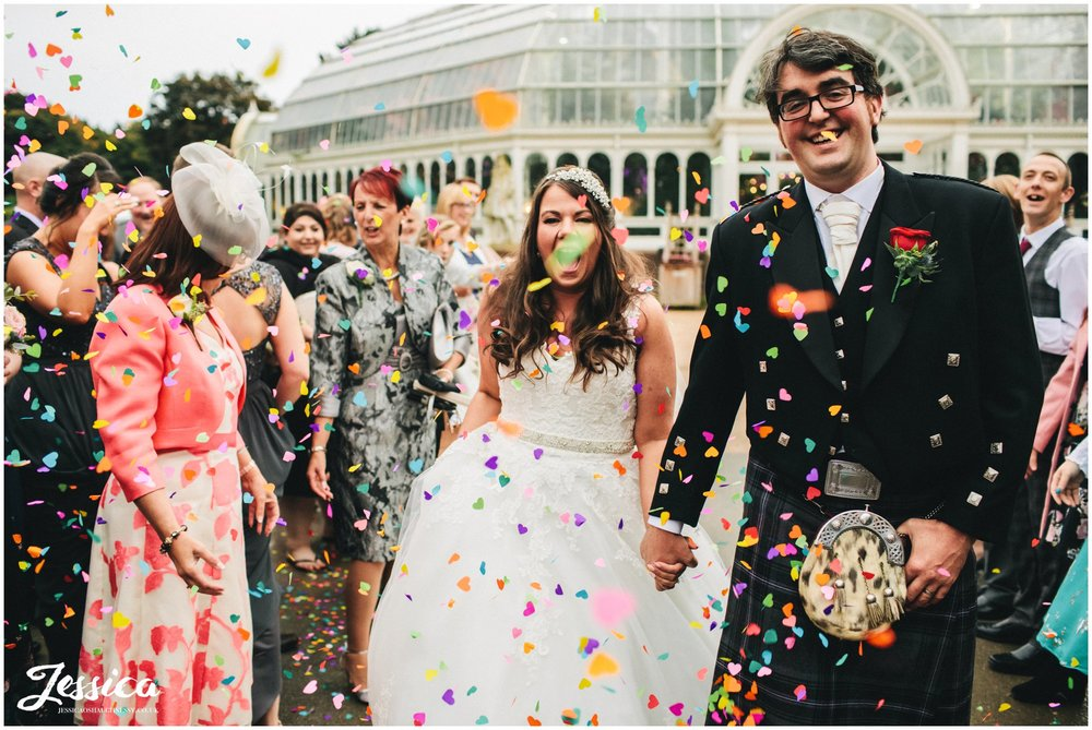 colourful confetti thrown over couple