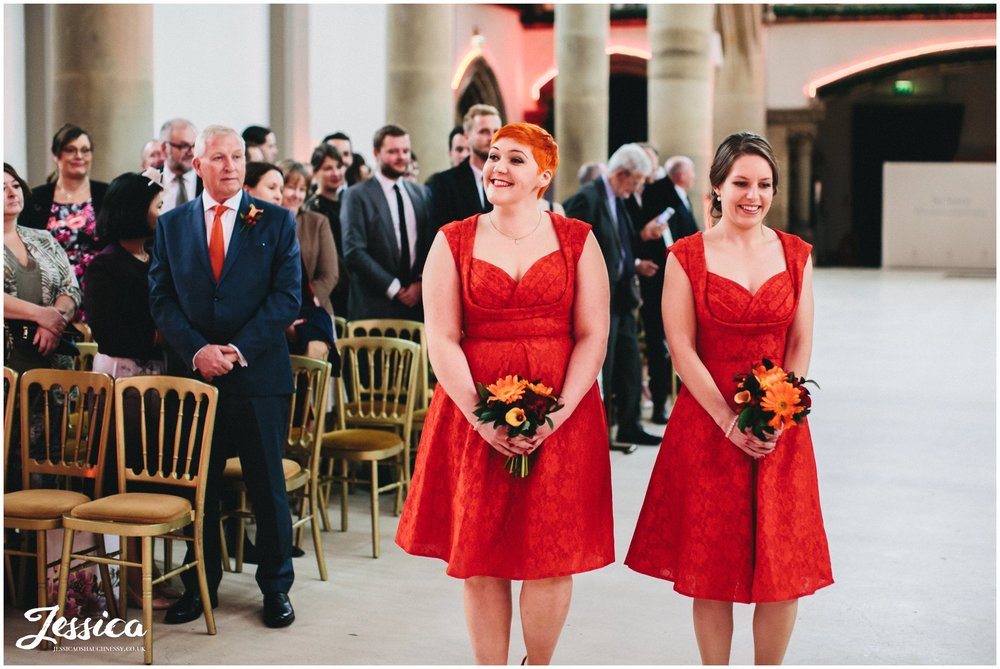 bridesmaids walk down the aisle at gorton monastery in manchester