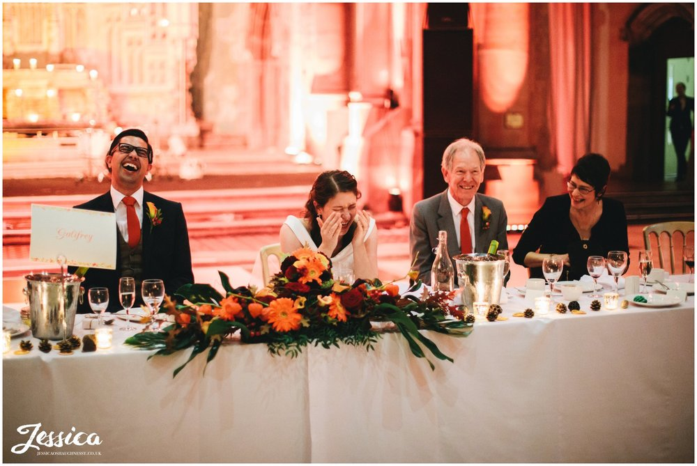 top table laughing during best man's speech