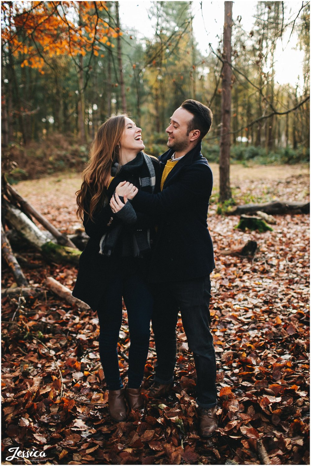 couple laughing together during their autumnal engagement shoot