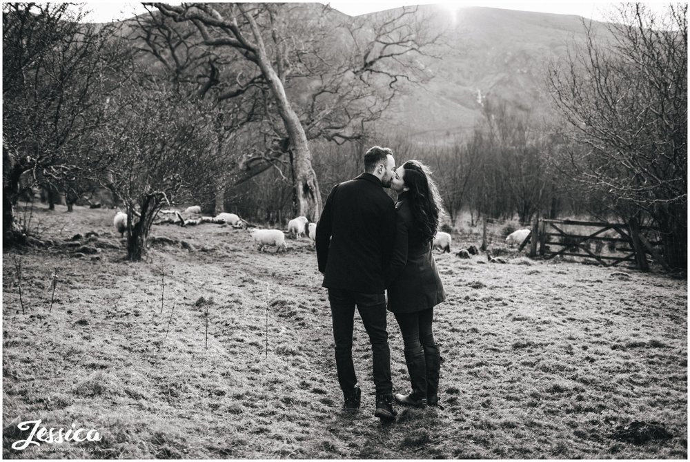black & white photo of couple kissing - aber falls, north wales