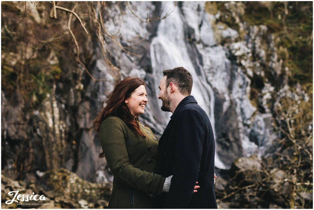 couple in front of aber waterfalls, north wales