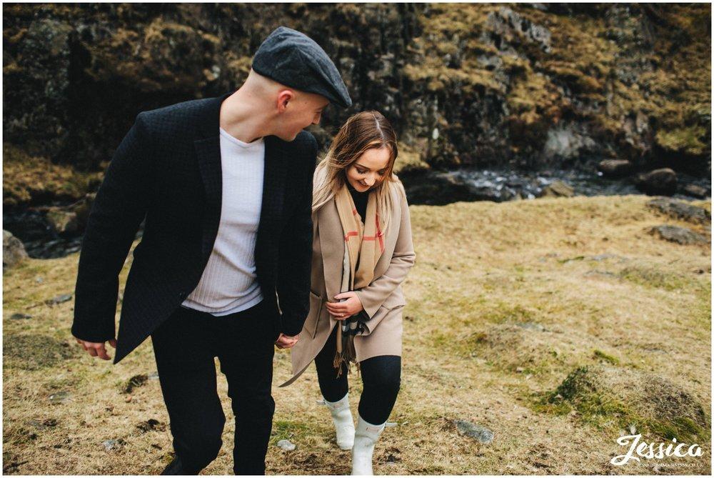 couple walk up bank of blea tarn lake - north wedding wedding photographer