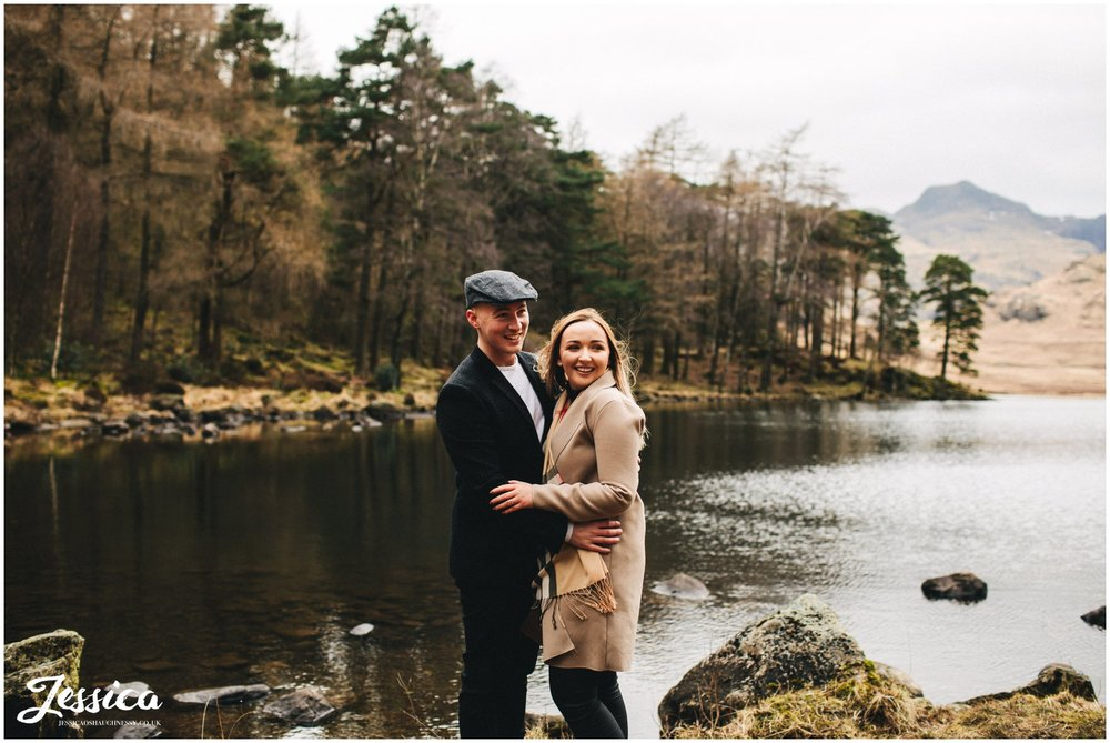 couple stand in front of blea tarn lake - lake district wedding photographer