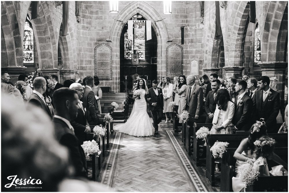 bride walks down the aisle - wirral wedding photography