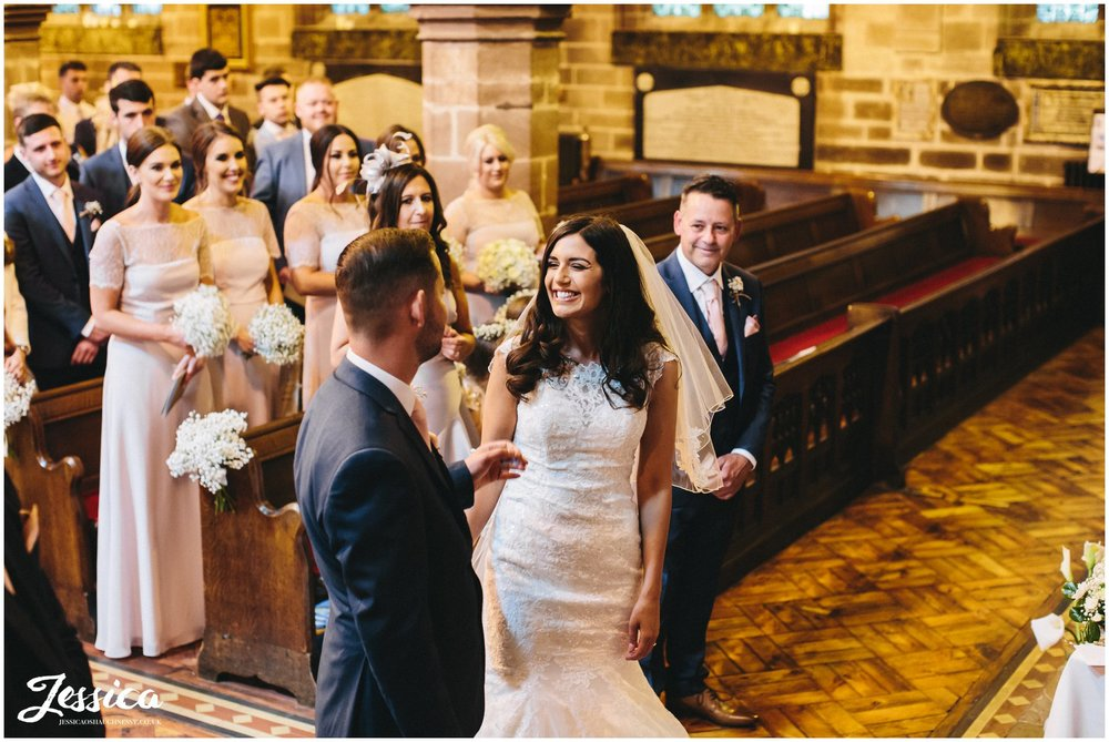 bride smiles lovingly at her new husband