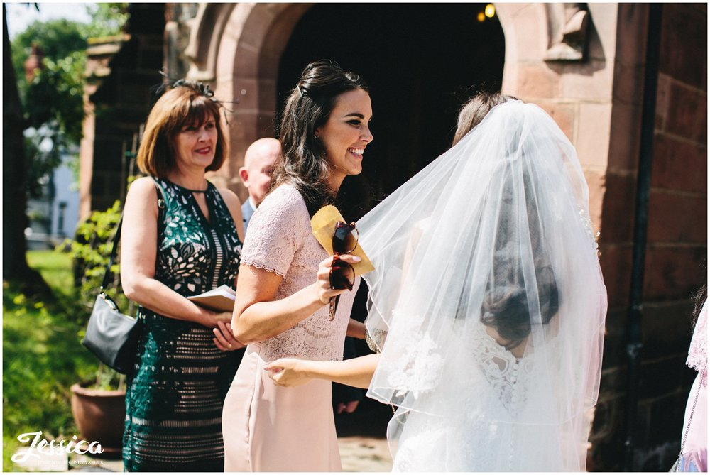 wirral wedding photography - guests smiling after the ceremony