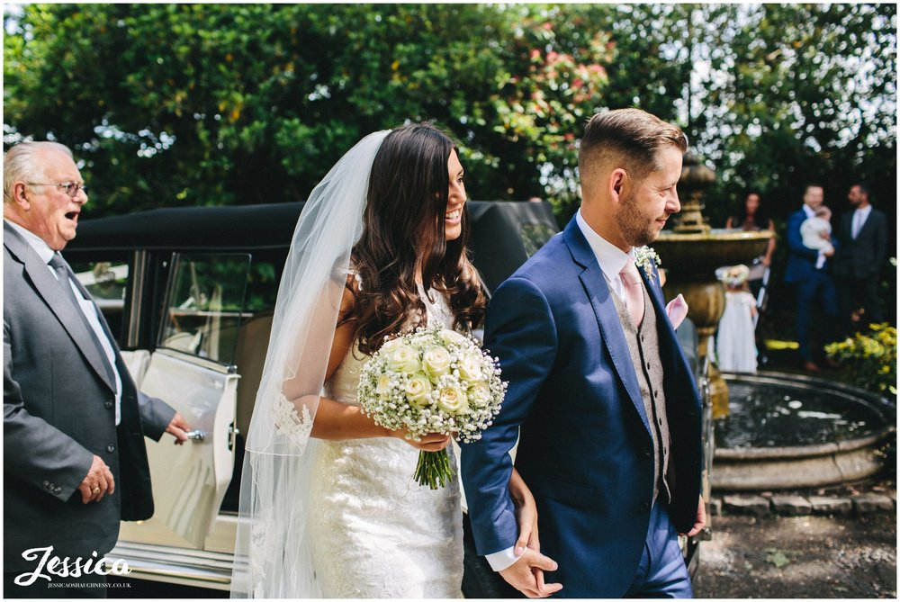 couple arrive at their wirral wedding venue