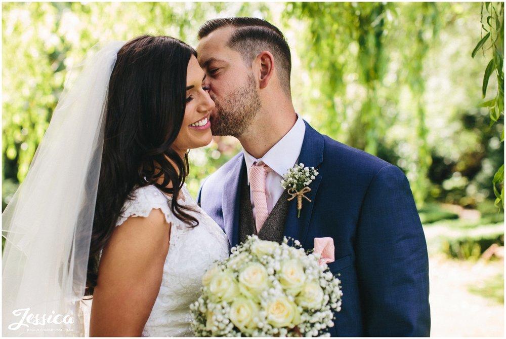 husband kisses wifes cheek