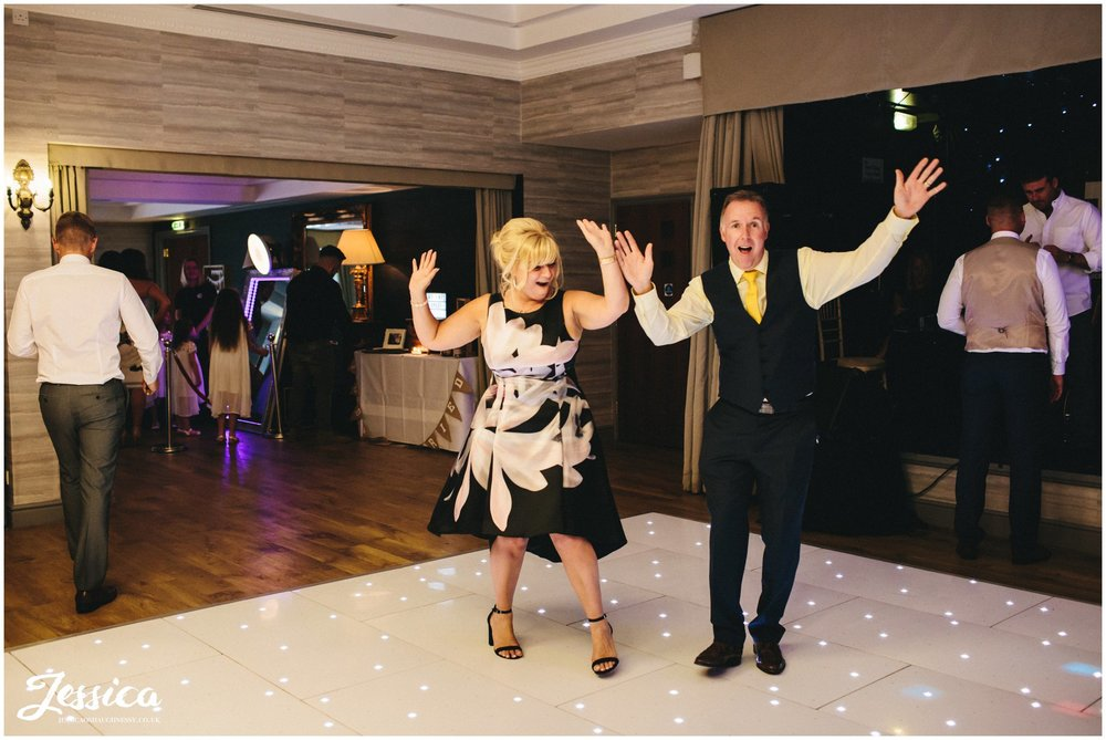 guests warming up the dancefloor at the wedding reception