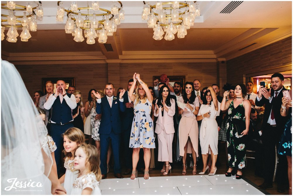wedding guests sing along to the first dance