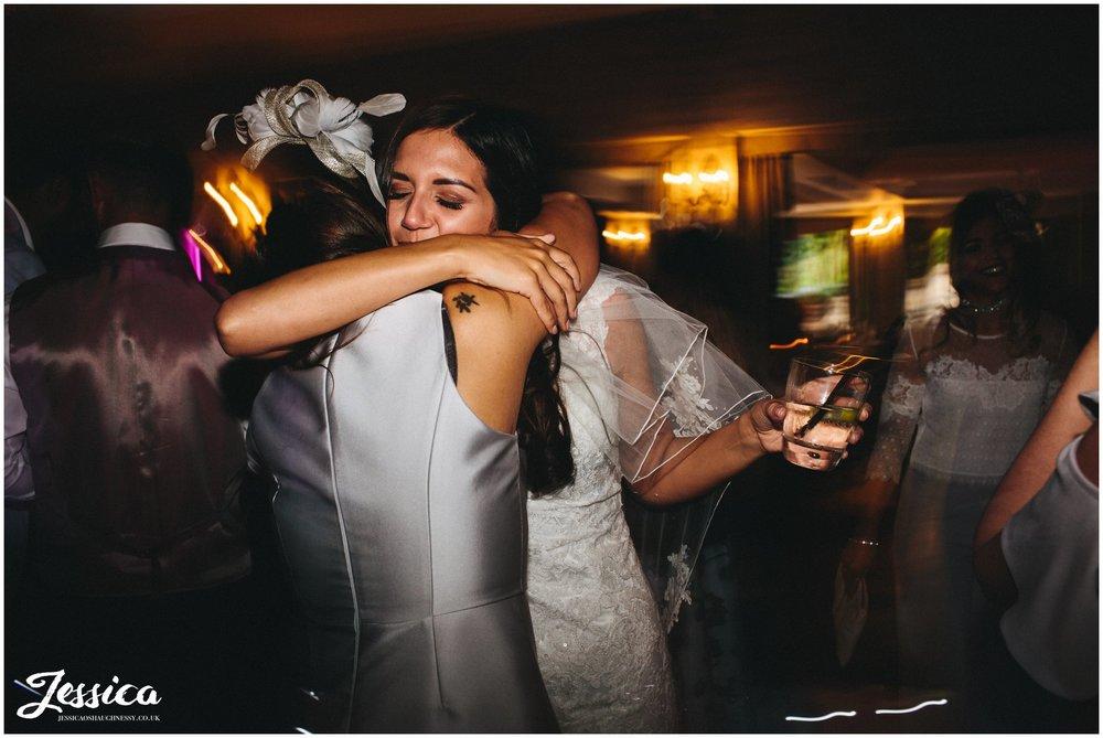 bride & mother hug on the dancefloor at brook hall hotel