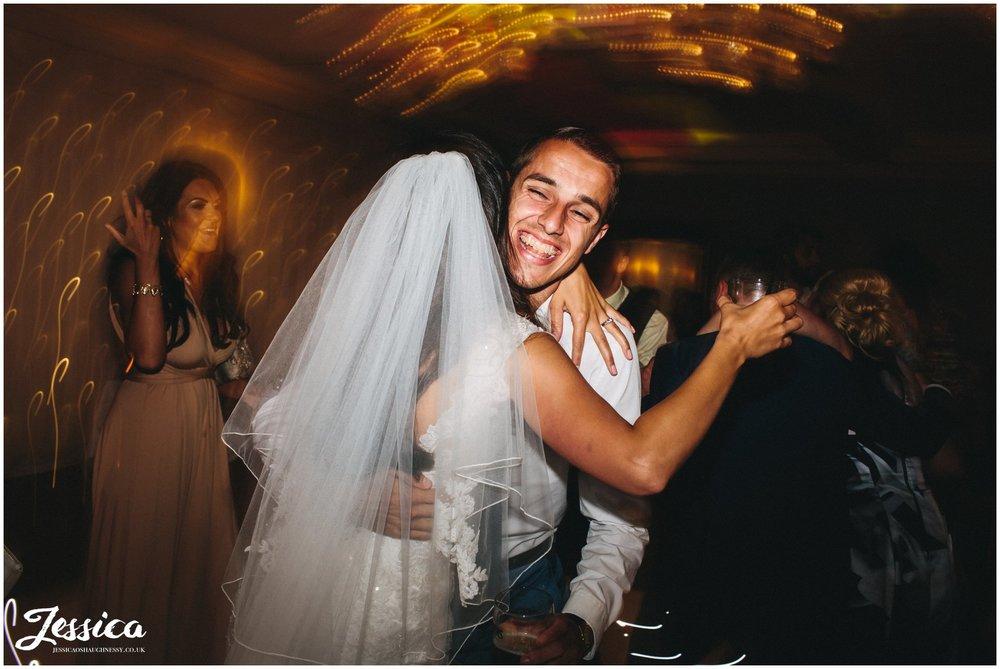 bride hugs her wedding guest