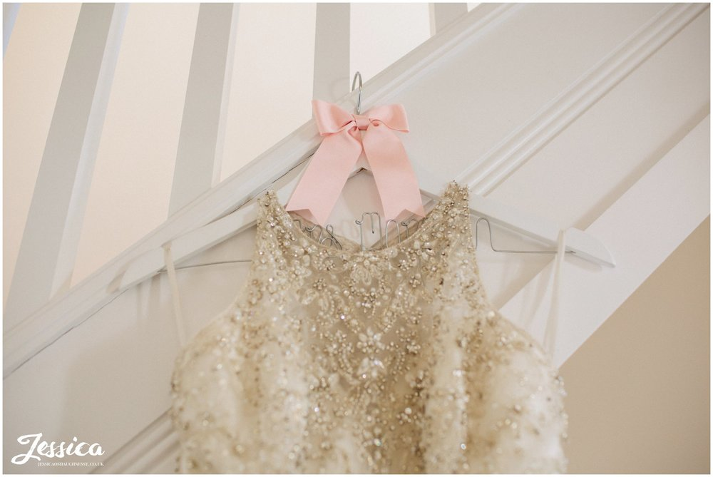 wedding dress hung ready for the bride