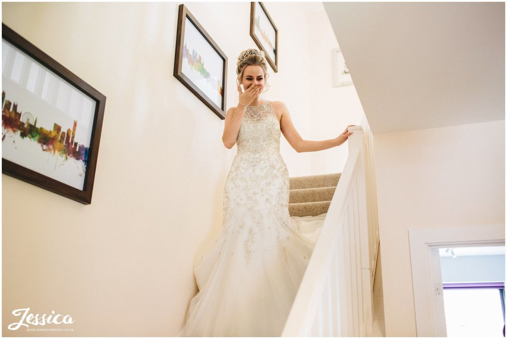 bride feels emotional walking downstairs to leave for the ceremony