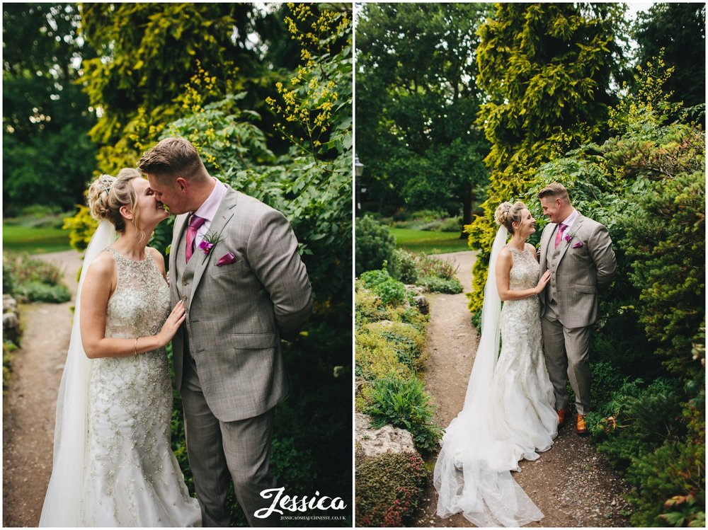 newly wed's in york museum gardens on their wedding day