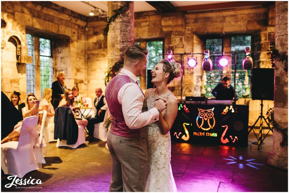 newly wed's share their first dance together at the hospitium
