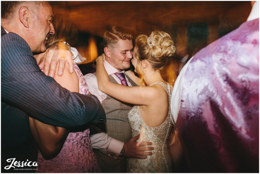 husband & wife dance together at the wedding reception in york