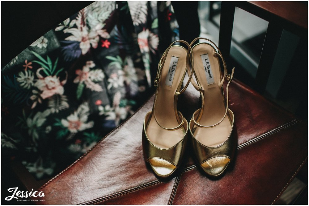 gold bridal shoes at a chester wedding