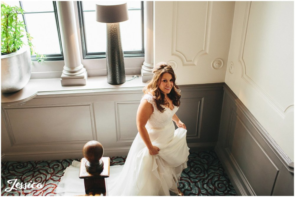 the bride walks up the stairs at oddfellows in chester