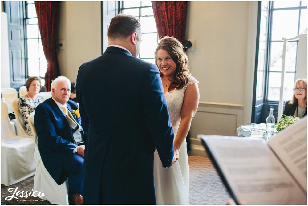 bride smiles at her groom during their chester wedding ceremony
