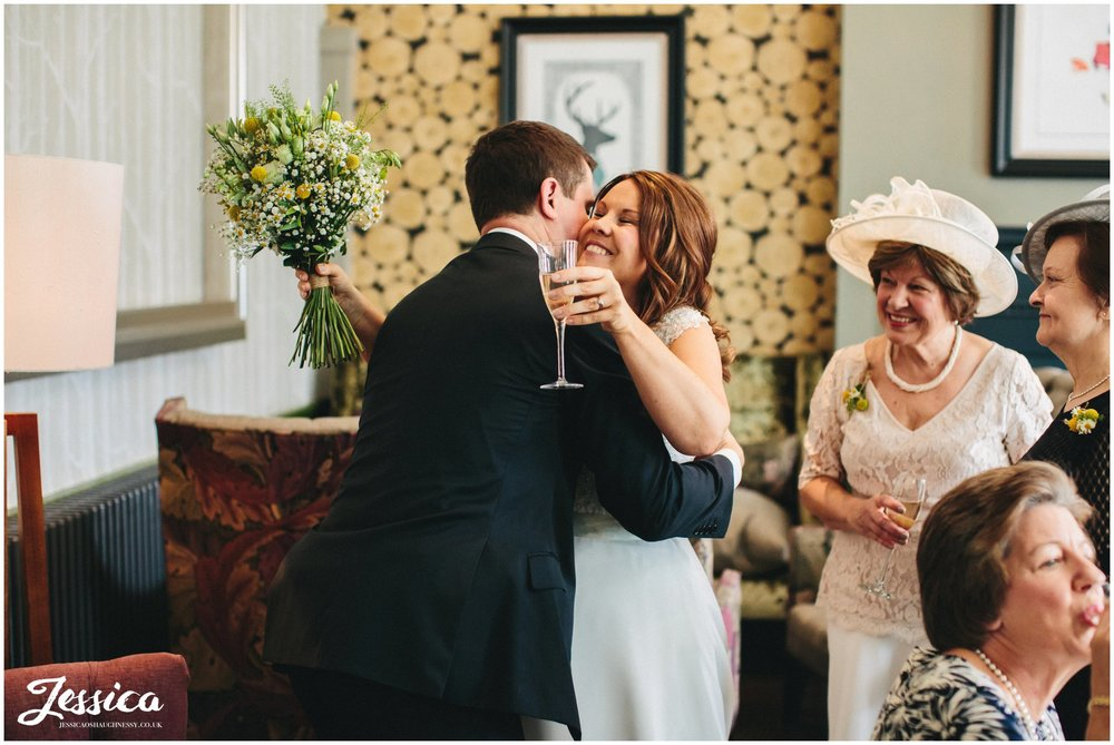 bride hugs a guest on her wedding day