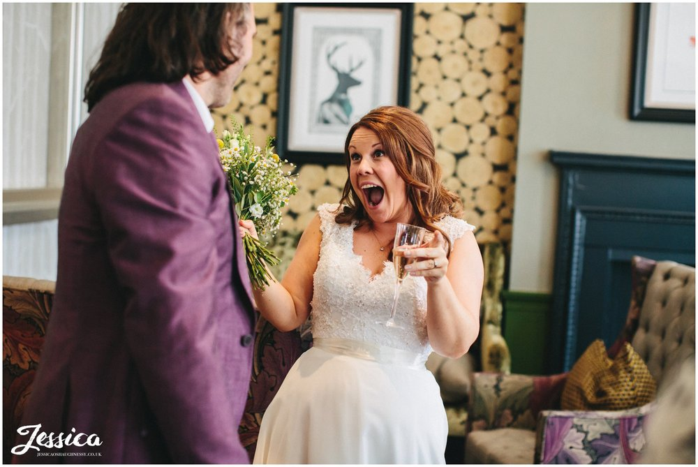 bride cheers in celebration