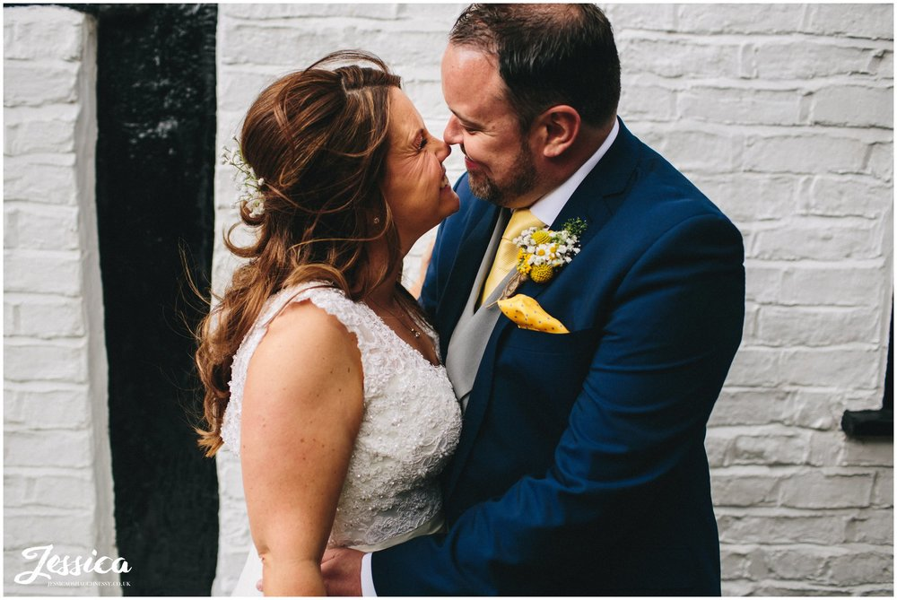 husband & wife embrace on their wedding day in chester