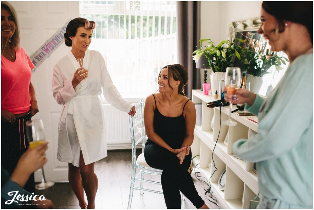 bridal party gets ready at the brides house for the wirral wedding