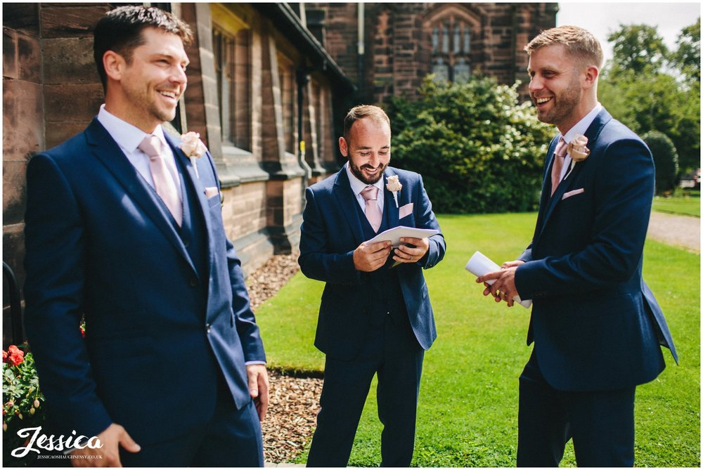 groomsmen great the guests as they arrive at the wirral church